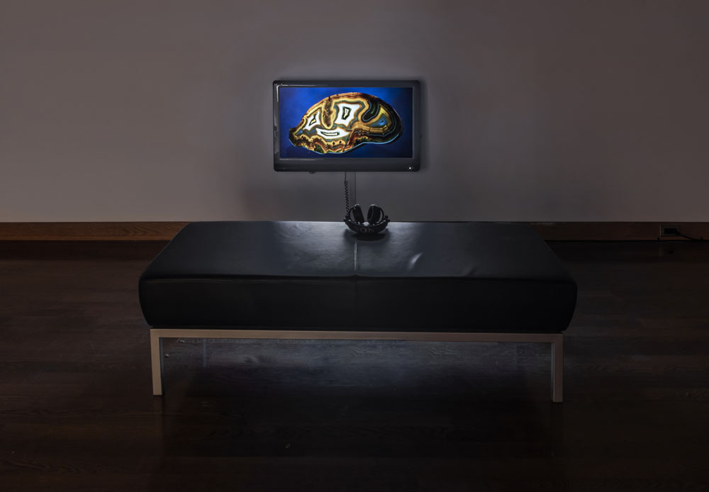 TV mounted low to a wall with an image of a smiling rock for sale on e-bay